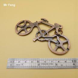 Bronze Color Metal Bike Puzzle Classic IQ Cast Ring Puzzle For Adults Children