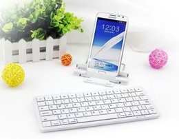 Wholesale Universal Wireless Bluetooth Keyboard with Srand for iPhone iPad Samsung HTC Tablet Nexus Black or white color KB
