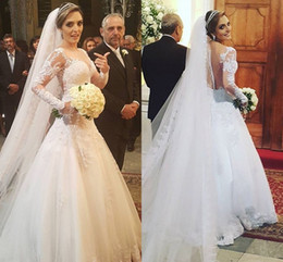 Vestidos 2016 New Lace A Line Wedding Dresses Illusion Jewel Neck Long Sleeves Appliques Beads Plus Size Sweep Train Sheer Back Bridal Gowns