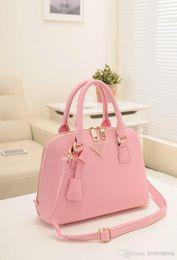 Wholesale 100 Brand designer pure leather tote bag messenger bag shoulder bag Fashion female bag shells handbag