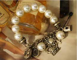 Wholesale New Arrival fashion retro antique bronze plated pearl bracelet with small charmings