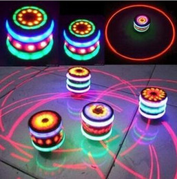 Wholesale Magic Music Gyroscope Toy Gyro Spinner Spinning LED Whirling Kids UFO Single Laser Colorful LED Peg Top Toy Christmas Gifts Free DHL