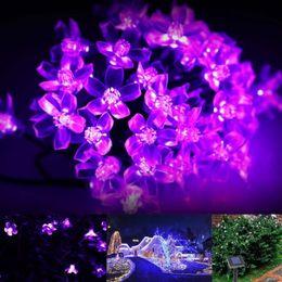 Цветковые деревья Онлайн-Рождественские светодиодные Строки Солнечные сказочных огней 23 фута 7М Цветок Струнные Водонепроницаемые 50 светодиодов 1,2 Теплый белый / Холодный белый / фиолетовый дерево Строки лампы
