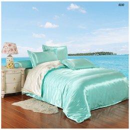 Ropa de cama de satén de seda lisa establece cama de seda edredón de seda de lino sábana funda de almohada de agua de color azul puro de la leche artificial white5030 desde edredones de seda pura proveedores
