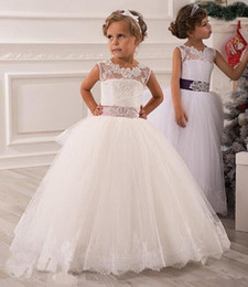 Pequeña novia vestido de niña de las flores en venta-2015 muchachas de flor vestidos Vestidos de novia de la boda de la ilusión corbata Keyhole desfile vestidos con la correa de los vestidos de bola Sheer con apliques