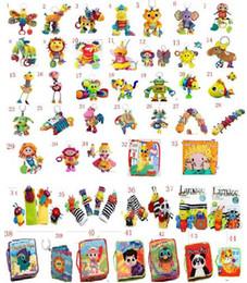 Tissu lamaze en Ligne-styles mélanger jouets Lamaze avec hochet de dentition infantile précoce Toy développement poussette clip Baby doll jouets Lamaze tissu Livres