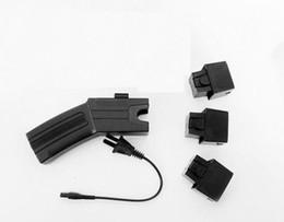 Wholesale M TYPE self defense Multifunctional flashlight with remote needle laser light alarm