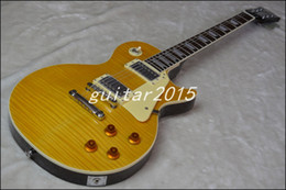 Wholesale Chinese guitar yellow maple tiger skin paste cream binding mahogany electric guitar