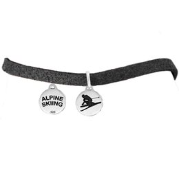 Wholesale factory price antique silver color simple design a round pendant message ALPINE SKIING pendant slider leather chain bracelets