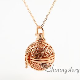 Wholesale flower openwork essential oil necklace aromatherapy jewelry perfume locket essential oil diffuser pendant metal volcanic stone
