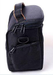 tracking number for Canon camera bag triangle bag 550D 600D 500D 1100D SLR Accessories SLR camera bag