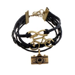 Wholesale 2016 Korean wax rope leather bracelet camera bicycle infinity alloy charm bracelet bijoux bangle for women and men
