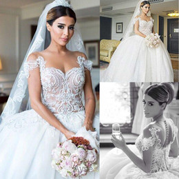 2015 Ball Gowns Wedding Dresses Sheer Crew Neckline Pearls Beaded Embroidery Ivory over Nude Chapel Train Tulle Wedding Dresses dhyz 01