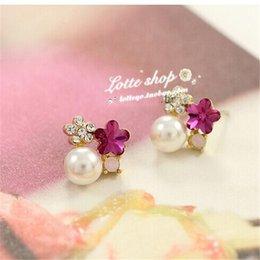 Woman wins the price star with five leaves and flowers earrings OL temperament diamond crystal pearl Korean version plum earrings