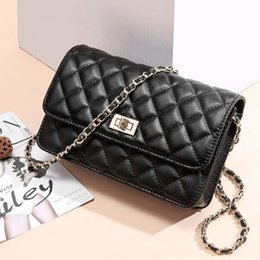 2019 Spring and summer small bag new fashion cowhide single shoulder crossbodybag metal case chain cross small square bag women's bag