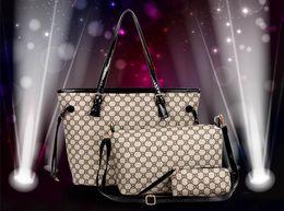 Wholesale Buy one get two free women handbag three pieces suit women shoulder bag and women messenger bag and women clutch