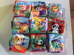 Tissu lamaze en Ligne-Jouets pour bébés jouets pour enfants lamaze le livre Rama Zerbe Habits de tissu 10 livres de styles jouets pour enfants en boîte Histoire de conte de fées