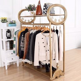High-end fashion boutiques display clothing racks display shelf upscale women's clothing store iron