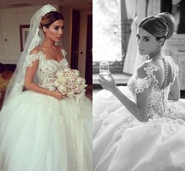 Romantic Ball Gown Wedding Dresses 2019 New Off Shoulder Appliqued Lace Sheer Covered Button Back Elegant Bridal Gowns Sweep Train