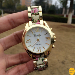 free shipping high style on a pretty bracelet watch and finished with a vintage floral print center links. Feel beautiful e
