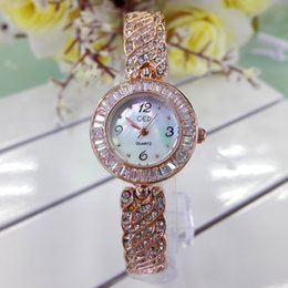 Wholesale New Fashion Hot Luxury Wristatches Artificial Gem gift Unique Rhinestone Elegant High Women Spiral Quartz Gloden The Fashion Flower watches