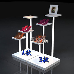 Clothing store shoe store window display low water table, wrought iron shoe rack garment bag rack shelf stand