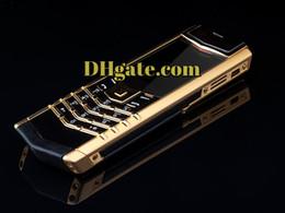 Nouveau modèle de luxe Gold Mobile Phone Designer débloqué Gold Gsm téléphones cellulaires Stnadart clavier caméra à partir de téléphones cellulaires concepteur fournisseurs