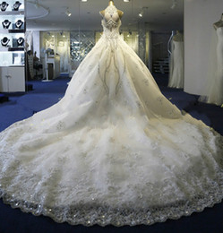 Luxury Jewel High Neck Sleeveless Ball Gown Wedding Dresses With Beads And Crystals Tulle Chapel Train Sheer Back Dresses Bridal Gowns