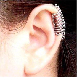 Wholesale 033 European and American trade wind cool pop punk skull spine bone ear clip earrings non pierced ear clip