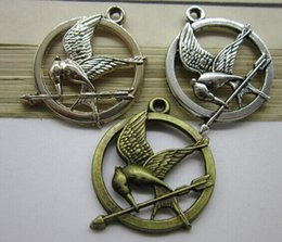 100pieces LOT 25mm ancient diy bronze silver bird hunger games badges charm pendant free shipping