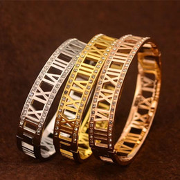 2015 New fashion silver rose gold plated stainless crystal rhinestone hollow roman numbers cuff bracelet jewelry for women