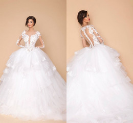 Sexy Arabic Sheer Long Sleeves Designer Wedding Ball Gowns Dubai Fashion 2019 New Lace Appliques Tiers Puffy Bridal Wedding Party Dresses