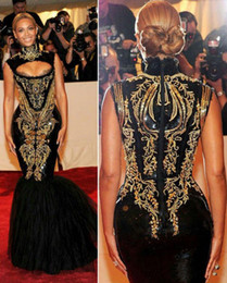 Wholesale 2015 Hot Sale Sexy Evening Gowns Beyonce Gala Black And Gold Embroidery Beaded High Neck Floor Length Mermaid Celebrity Dresses