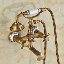 Wholesale And Retail Promotion Ceramic Antique Brass Bathroom Tub Faucet Phone Style Dual Handles Tub Spout W Hand Shower