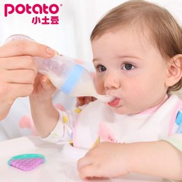 Wholesale Small potatoes baby extruded rice paste the silica gel Rice noodles bottle baby feeding spoon of complementary feeding spoon tab