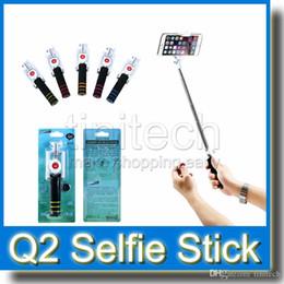 Promotion contrôleur bluetooth pour monopode Selfie Monopod Q2 Extensible Selfie Stick Handheld Monopied avec caméra Bluetooth Obturateur Télécommande New Coming