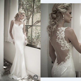New Arrival 2015 Spring Sexy Mermaid Wedding Dresses Spaghetti Straps Lace Appliqued Beach Backless Court Train Bridal Gowns