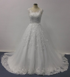 Bellissima Wedding Dresses 2016 Ball Gown Sheer V Neck Cap Sleeves Lace Appliqued Chapel Train Real Image Designer Bridal Gowns
