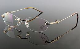 Elegant & Noble female rimless glasses frame super-light Golden color for prescription glasses 6602