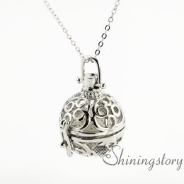 round openwork aromatherapy necklace diffuser lockets wholesale jewelry scents diffuser pendant necklaces metal volcanic stone