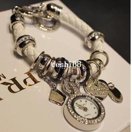 Descuento cuero reloj pulsera corazón Moda para mujer Corea del cuero genuino del estilo de la pulsera del corazón pendiente multi reloj pulsera reloj de las mujeres visten el envío libre