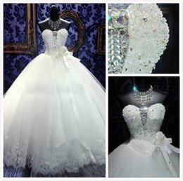 2015 Ball Gown Wedding Dresses Beaded Crystal Sweetheart Lace Princess Gowns Appliques Strapless Chapel Train Bridal Gowns Handmade Flowers