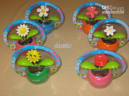 Descuento flor oscilación solar fresco Flip Flap flor swing planta Cool Car decoración solar Powered Dancing flores muñeca muñeca coche