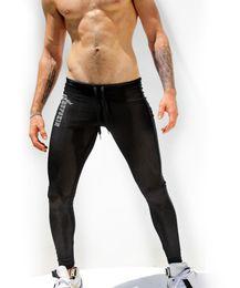 Wholesale-1pcs Mens Sexy Long Pants AQUX Brand Tight Sport Pants lowwaist Gym Fashion casual Leisure New mesn sheer Slim Straight hot