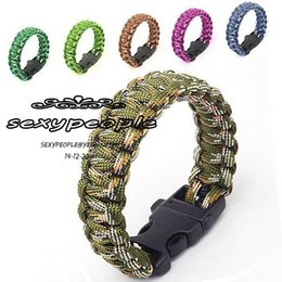 Wholesale 189 outdoor products survival escape life saving umbrella rope paracord hand made with whistle plastic buckle multicolor woven bracelets