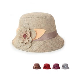 Wholesale The new spring and summer sun hat hat lady flax Flower Princess Hat a hollow air travel cap