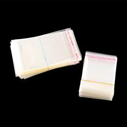 Claro Pequeño resellable celofán / BOPP / Poly Bolsas 5x10cm bolso transparente de OPP Embalaje bolsas de plástico 1000pcs sello auto-adhesivo desde pequeñas bolsas de plástico adhesivo transparente fabricantes
