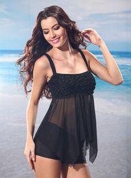 Tankini negro l en venta-Las mujeres atractivas rayadas del traje de baño del negro del traje de baño de la alta calidad que el acoplamiento Backless de la correa de los juegos de baño de la correa usan S-XXL de la playa
