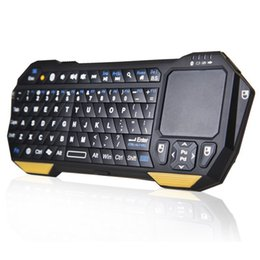 Wholesale Best Top Computer PC Wireless Laptop Compact Bluetooth IR Remote Lighted keyboard with Touchpad for Gaming BT04