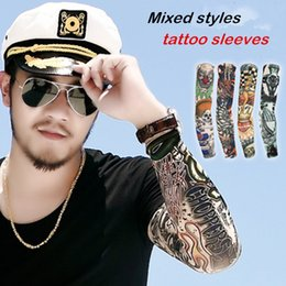 Wholesale-NEW unisex High elastic Fake temporary ultraviolet-proof tattoo sleeve mixed designs body Arm stockings tatoo fishing sleeves